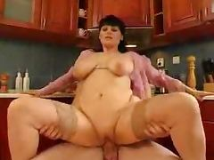 Mature Housewife has wild sex with a plumber in the kitchen