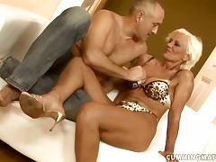 Mature whore gets some help using her fucking machine