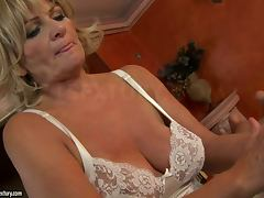 mature woman gets cum on her tits