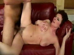 Curly granny loves the taste of that huge cock