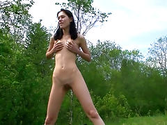 Sporty babe Yulia is getting naked in the forest