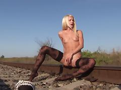hot blonde pleasuring herself on deserted railtrack