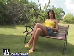 Evelyn the sexy brunette toys herself outdoors