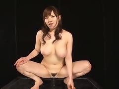 Azusa Nagasawa takes a ride on a big black dildo attached to the floor