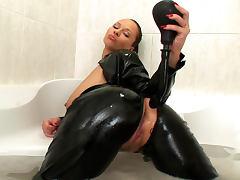 Nasty brunette Dominno is masturbating in the bathroom