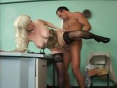 Mature blonde in stockings gets fucked cowgirl in an office