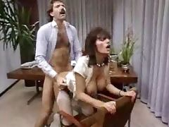Curly office woman gets fucked on a table in retro video