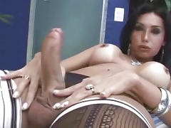 Busty brunette tranny hottie tugs her cock outdoors