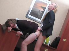 Two lewd shemales have some naughty banging in an office