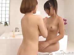 Two sweet Japanese girls have lesbian sex in a bathroom