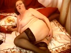 65yo Russian granny is dildoing her ass