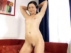 Liliane fingers her pussy before smashing it with a toy