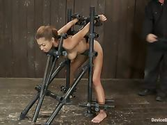 Angel Cummings gets fucked from behind while being in a pillory