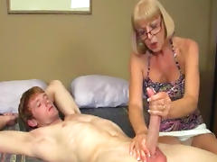 Mature mom gives a hot handjob