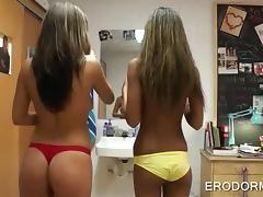Topless college hotties having fun in bedroom