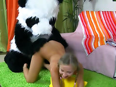 Tanned teen with pigtails is fucking with panda