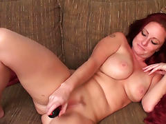 Fake-tit redhead babe Sandi Lymm is poking her shaved puss