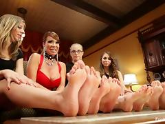 Four stunning girls show their feet and have lesbian sex