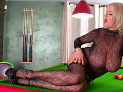Blonde poses in her sexy bodystocking