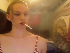 Mature Tmilf enjoying a strong cigarette