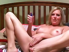 Blonde is lying on the bed and masturbating her pussy porn video