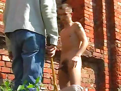 Brunette gay gets spanked outdoors by his master