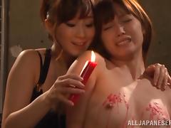 lesbian domme uses candle wax
