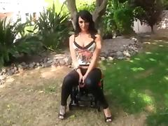 Busty babe rides the Monkey Rocker