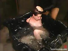 Slim Nina gets whipped and tortured in water bondage vid