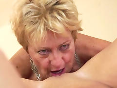 Mature blonde eats alluring brunette's pussy