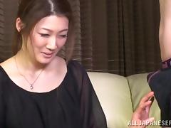 Japanese milf gives an awkward blowjob to some guy