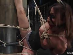 Amber Rayne gets chained, fucked with a dildo and drowned