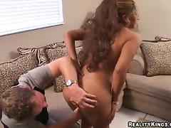 Curly Felicia gets fucked deep in her vagina on a sofa