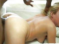 Busty shaved blonde gets deep black cock anal