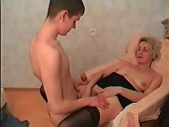 Elder mom in stockings & guy