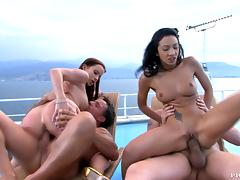 Two Dazzling Brunettes Having Outdoors Sex in Foursome on a Ferry