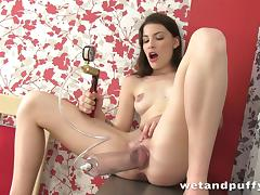 brunette pumping her pussy
