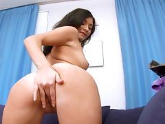 Malina is stroking her shaved puss beside a flower