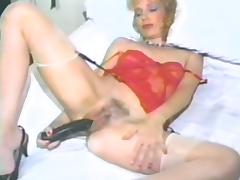 Mature blonde masturbates concerning output strengthen