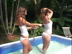 Hot babes have a lesbian moment in an inflated pool