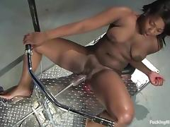 Busty Black chick gets toyed by the fucking machine