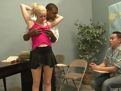 Slim blonde gets fucked by a black stud in the presence of a voyeur