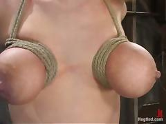 Her tits are tied and spread on both sides