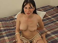 Dark-haired milf shows her body and milks a cock dry on her hand