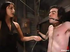 Horny chick suspends this skinny man and fucks him with a strapon