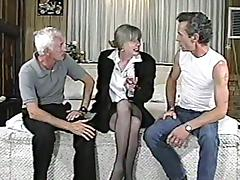 Mature lady is getting dicked by two mature men