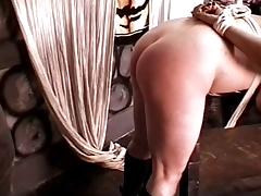 Slut with big juggs bent over for a spanking session