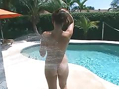 Nude bitch gives hand to some dude on the poolside