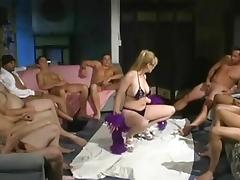 Curvaceous blonde enjoys a bukkake orgy
