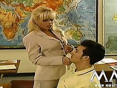 Sexy blonde teacher seducing her student in class